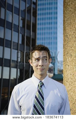 Mixed race businessman standing outdoors