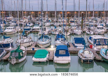 Brighton, England. 13 April 2017.Boats yachts and fishing boats moored at Brighton Marina docs on a cloudy day.