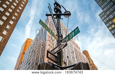 Street signs of Broadway and West 39st in Manhattan, New York City