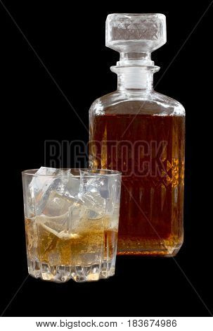 Glass and bottle whiskey on wooden table