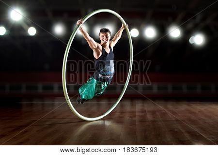 Circus acrobat in a Cyr Wheel