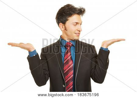 Business man comparing two invisble products on his hands
