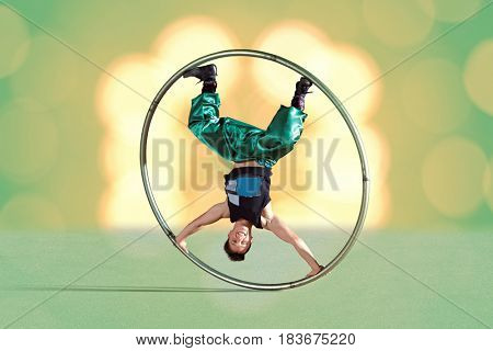 Circus acrobat in a Cyr Wheel