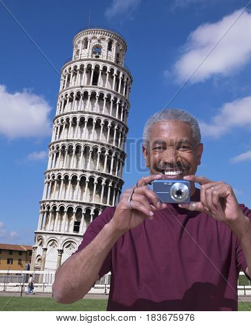 African American man standing near Leaning Tower of Pisa