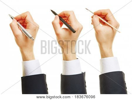 Three hands holding pen and brush and ballpoint pen