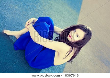 An Attractive Lady Sitting In A Rest