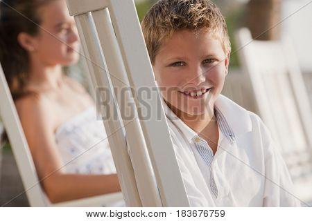Smiling Caucasian boy sitting in chair