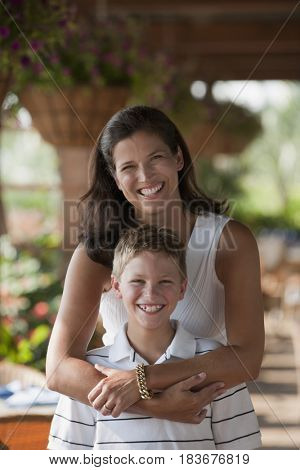 Caucasian mother hugging son