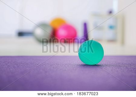 Stress ball on floor in clinic