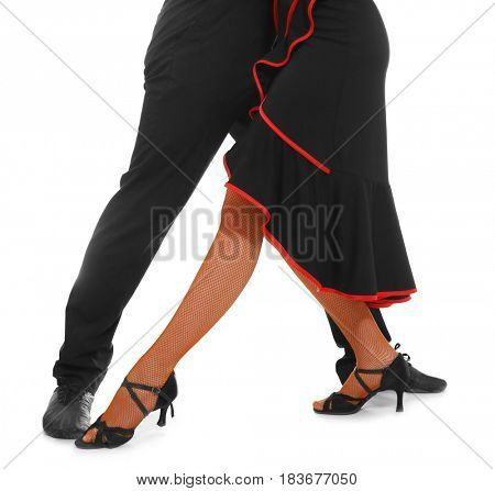 Legs of young dancers on white background