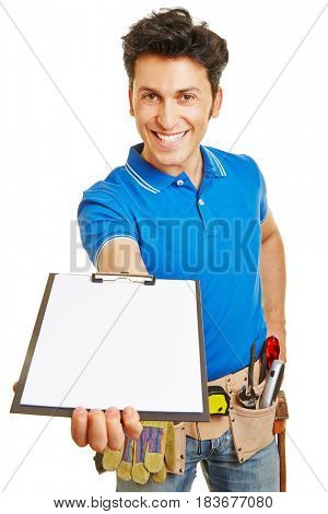 Smiling craftsman holding an empty white clipboard in his hand
