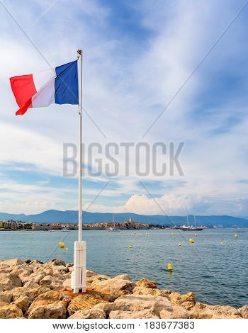 view over Antibes bay with France flag and alpes maritimes from Cap d'Antibes Antibes