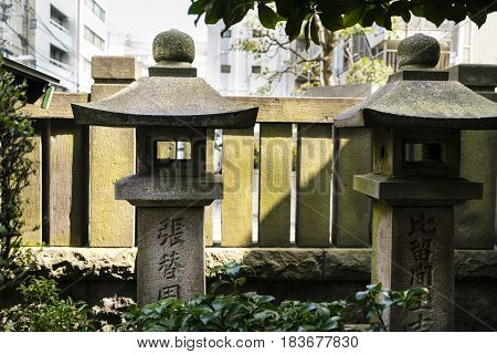 Stone carvings in a Shinto shrine in Tokyo Japan -  neighbourhood of Asakusa