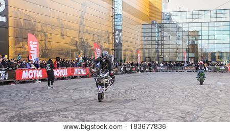St. Petersburg Russia - 15 April, Group of bikers on the site,15 April, 2017. International Motor Show IMIS-2017 in Expoforurum. Sports motorcycle show of bikers on the open area.