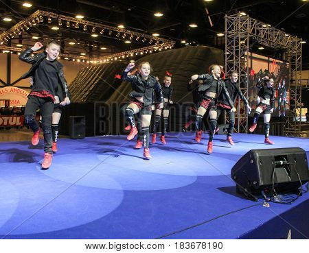 St. Petersburg Russia - 15 April, Active dances on stage,15 April, 2017. International Motor Show IMIS-2017 in Expoforurum. Dance show group of teenagers in the style of hip-hop.