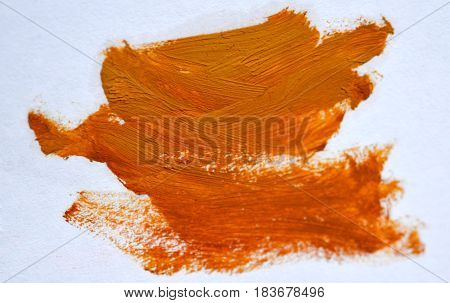 Orange Yellow spot Oil paint on a white background isolated smeared. Abstract creative background