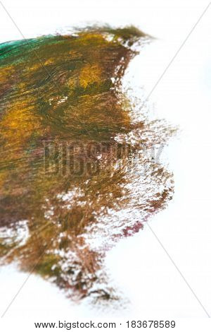 Dirty brown spot Oil paint on a white background isolated smeared. Abstract creative background