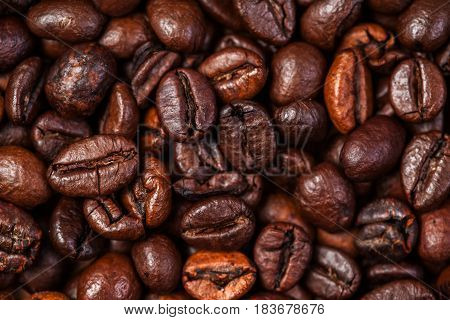 Coffee beans macro on a brown background..