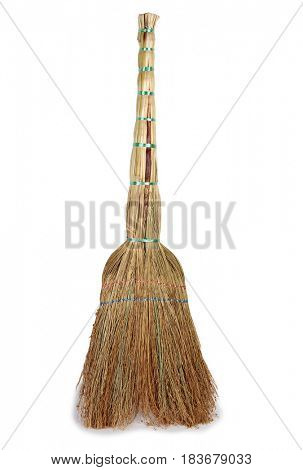 Old broom for cleaning on a white background