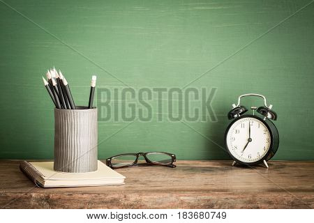 Books and pencil on wooden table,Back to school supplies education of concept