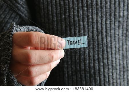 The guy holds a tag with the text in his hand