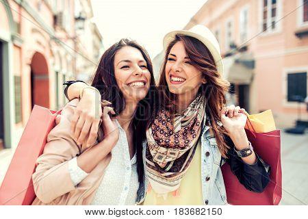 Two beautiful young women enjoying shopping in the city.