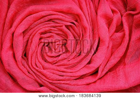 Closeup of red draped fabric for background. Flat lay. Top view.