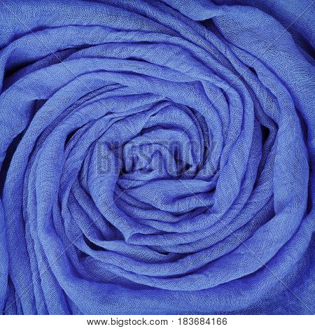 Closeup of blue draped fabric for background. Flat lay. Top view.