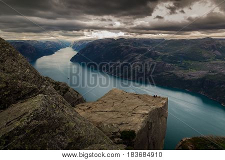 Preikestolen or Prekestolen (Preacher's Pulpit or Pulpit Rock) is a famous tourist attraction in the municipality of Forsand in Rogaland Norway. Preikestolen is a steep cliff which rises 604 metres above the Lysefjorden