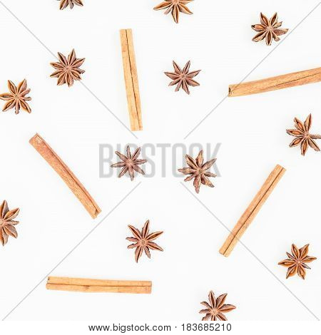 Natural pattern of cinnamon and anise tree on white background. Spice. Flat lay. Top view.