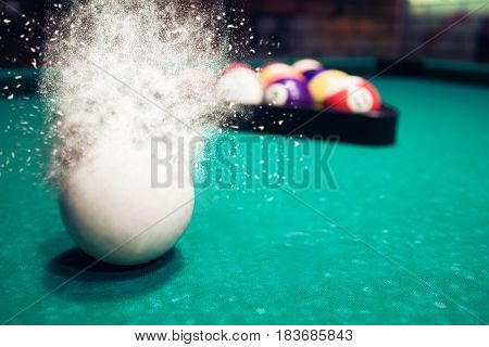 White Billiard Ball Breaks Up Into Particles And Debris