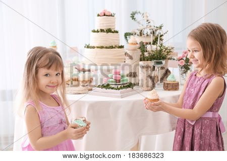 Cute girls with sweets at party