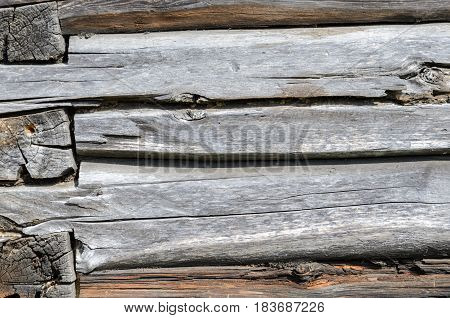 Rustic Log Wall Horizontal Grey Gray Background. Fragment Of Unpainted Brown Wooden Debarked Logs
