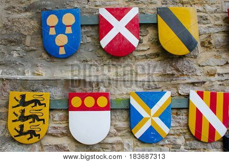 Group of heraldic shields hanging on walls
