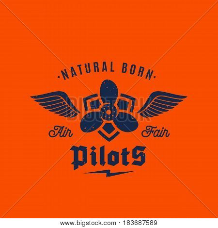 Natural Born Pilots Airplane Vector Retro Label, Sign or Logo Template. Airscrew on the Shield with Wings and Typography. On Orange Background.