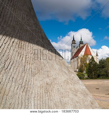 Flag monument and St. Johannis-Church on the banks of the river Elbe in Magdeburg.