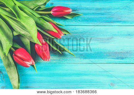 Bouquet Of Pink Tulips On Blue Wooden Background. Top View, Copy Space. Happy Mother's Day.