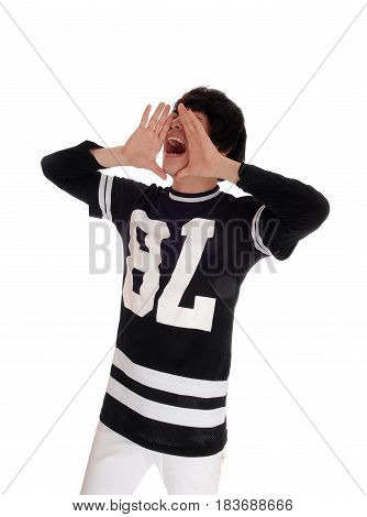 A slim young Korean man holding his hands on his mouth and shouting with his mouth open isolated for white background.