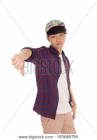 A handsome Asian man standing gesturing with his thump down in a checkered shirt and cap isolated for white background.