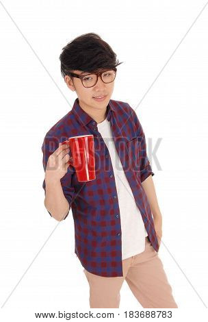 A young Korean man standing in a checkered shirt holding a red coffee mug isolated for white background.