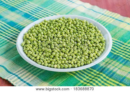 Fresh Green Peas In A Ceramic Bowl On Table.