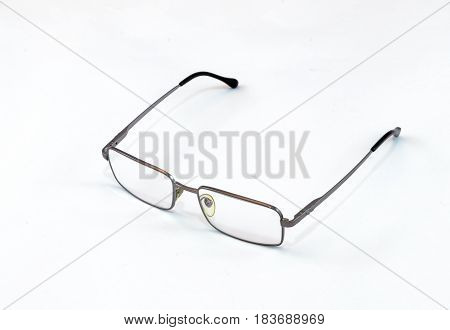 Metal Reading Glasses With Black Plastic Shackles On White Background