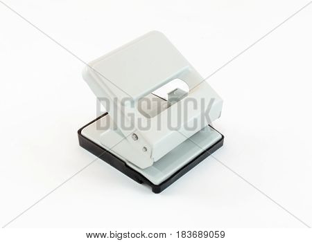 Beige Puncher With A Black Plastic Pallet On White Background