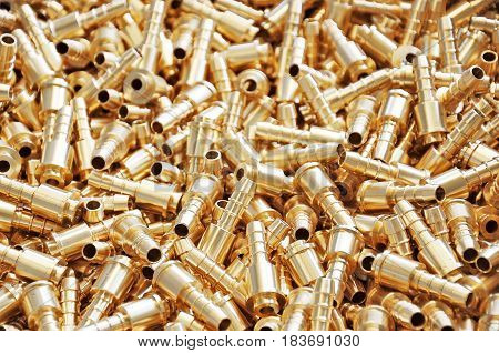 background of pile newly made brass fittings