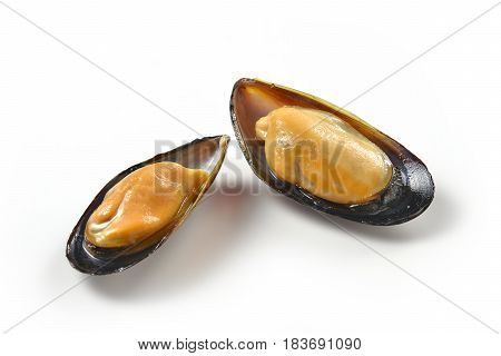 Two open mussels isolated on white background
