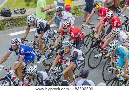 Col de PeyresourdeFrance- July 23 2014: Upper view of the peloton (gruppetto) climbing the road to Col de Peyresourde in Pyrenees Mountains during the stage 17 of Le Tour de France on 23 July 2014.