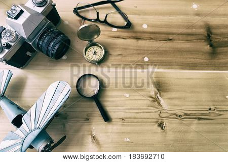 Tourism Planning And Apparel Needed For The Trip On Wood Table. Travel Accessories, Eyeglasses, Came
