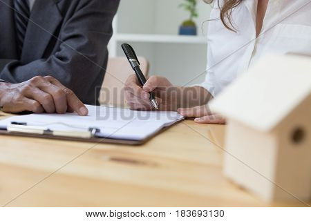 Person's Hand Hold Ballpoint Pen Writing On Contract Agreement Paper Sheet, Fill In Document Templat