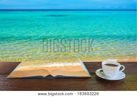 Coffee Mug And Book The Sea On Old Wooden Table