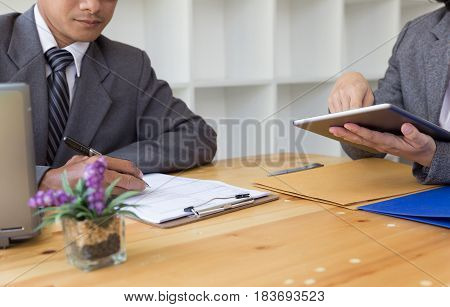 Applicant's Hand Holding Ballpoint Pen Writing On Empty Application Form Paper. Business Person Fill
